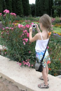 girl with camera on a photo safari
