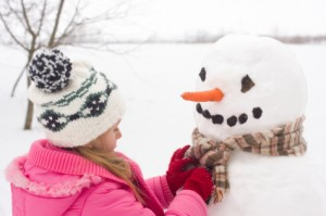 Little girl make snowman